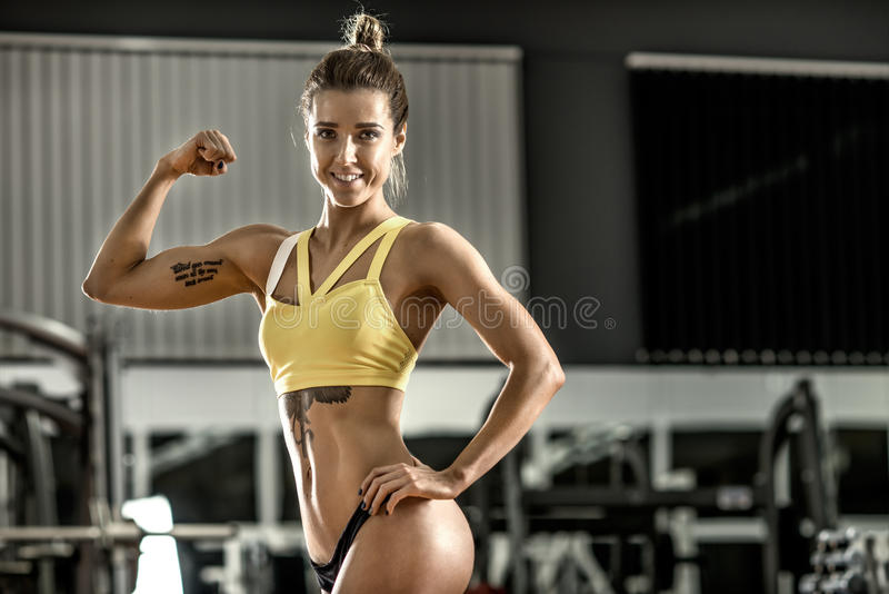 Young fitness woman in gym. Smile, horizontal photo stock images