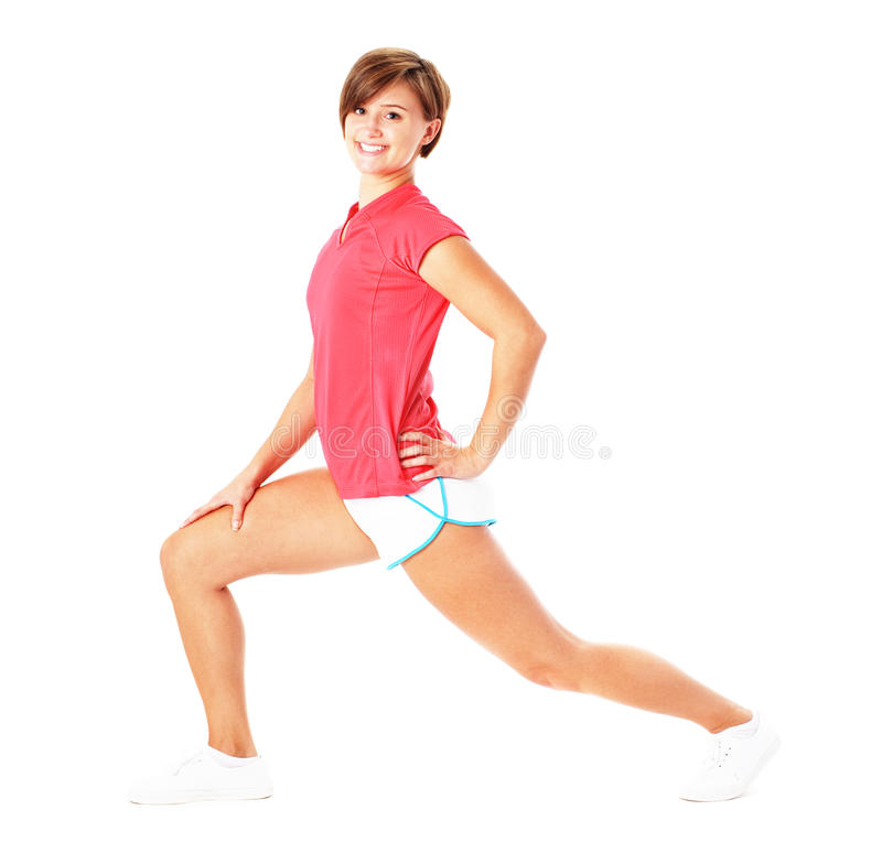 Young Fitness Woman in Red Shirt Stretching, Isola stock photography