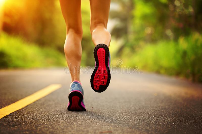 Fitness woman runner running on the forest trail stock image