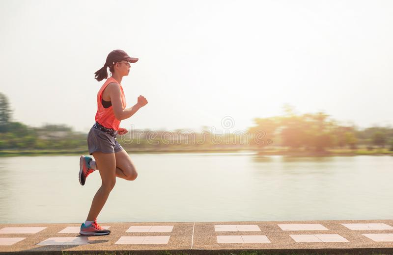 Young fitness woman running in the park royalty free stock photos