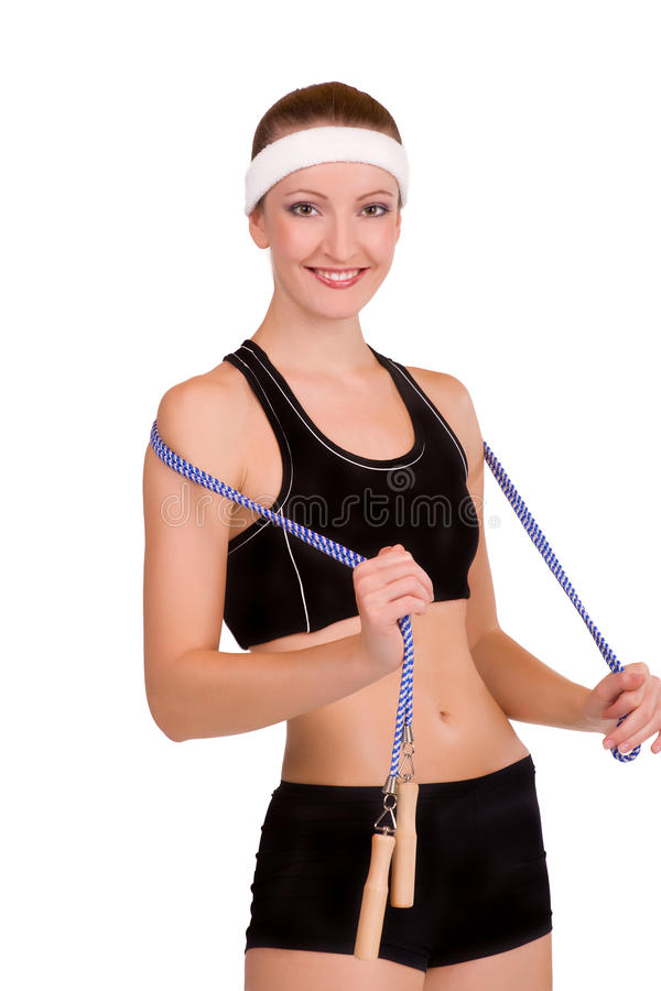 Young fitness woman with skipping rope. Isolated in white royalty free stock images