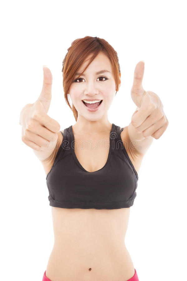 Young fitness woman with thumbs up stock photos