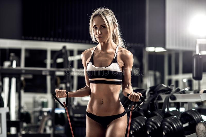 Young fitness woman. Execute exercise in gym, horizontal photo stock photo