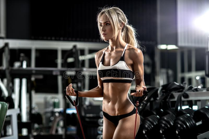 Young fitness woman. Execute exercise in gym, horizontal photo stock photography
