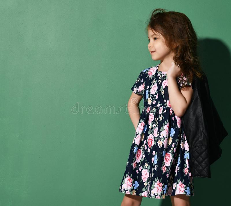 Young five years old girl kid posing in summer dress on green stock photos
