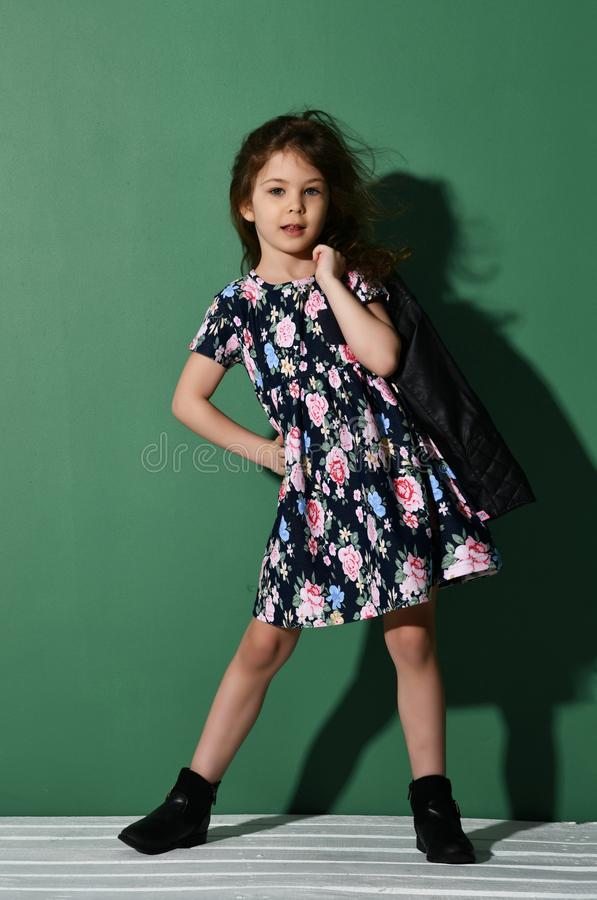 Young five years old girl kid posing in summer dress on green royalty free stock photography