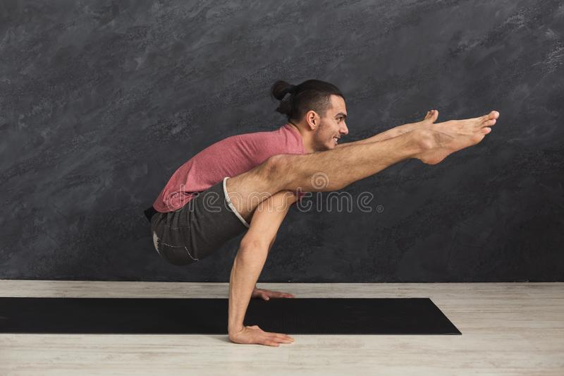 Young flexible man standing on hands royalty free stock photos
