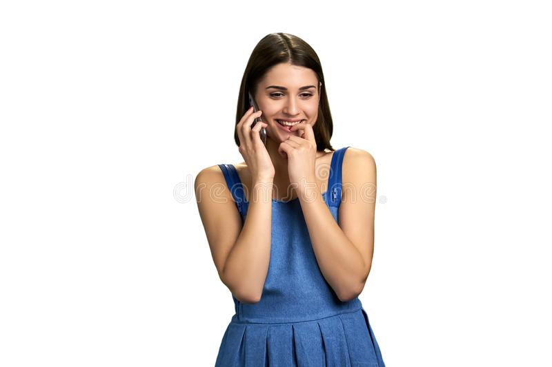 Young flirty woman talking on phone. stock photography