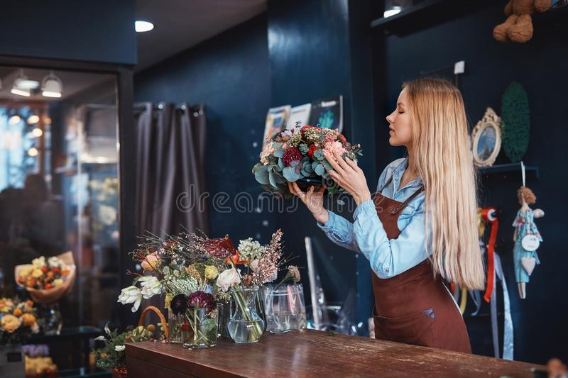 Young florist with bouquet of flowers royalty free stock photos