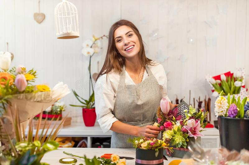 Young florist woman in a flower shop royalty free stock photography