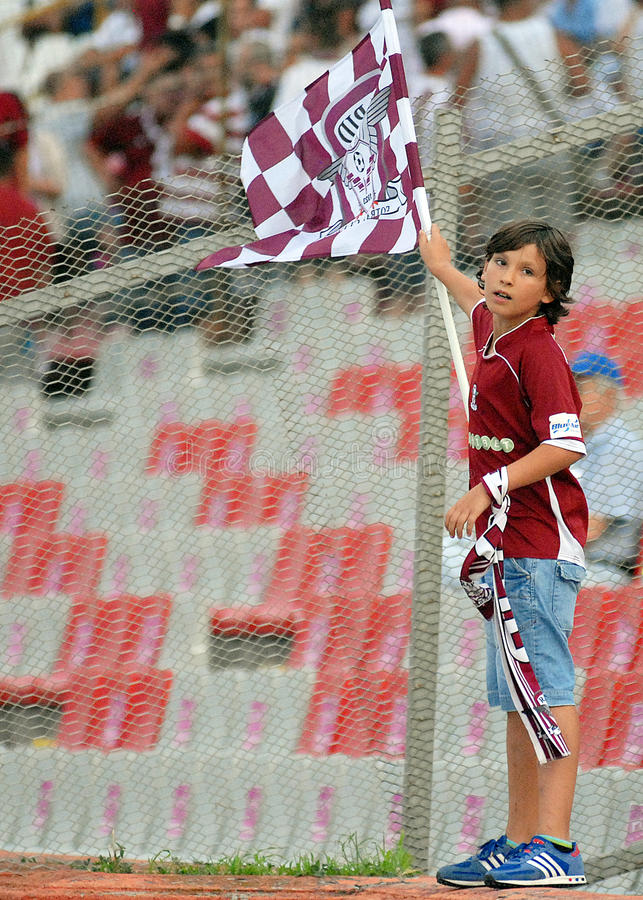 Young Football Fan Waving A Flag Editorial Photography