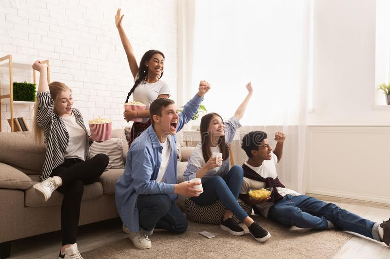 Young football fans. Friends cheering for favourite team stock image