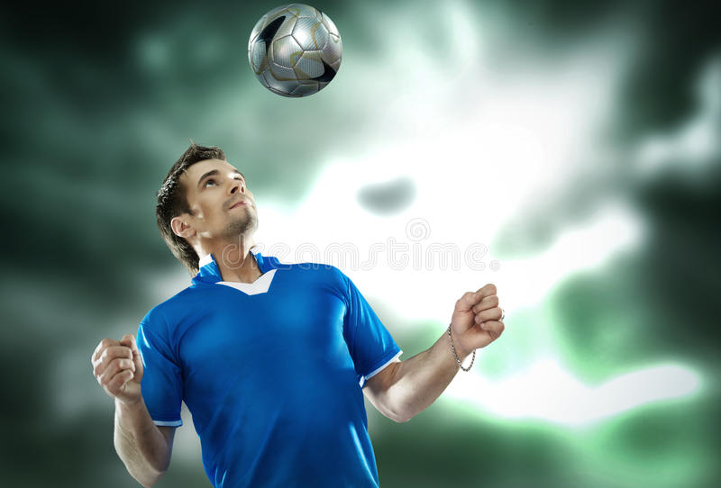 Download Young Football Player With Ball On Isolated Backgr Stock Image - Image: 19024279