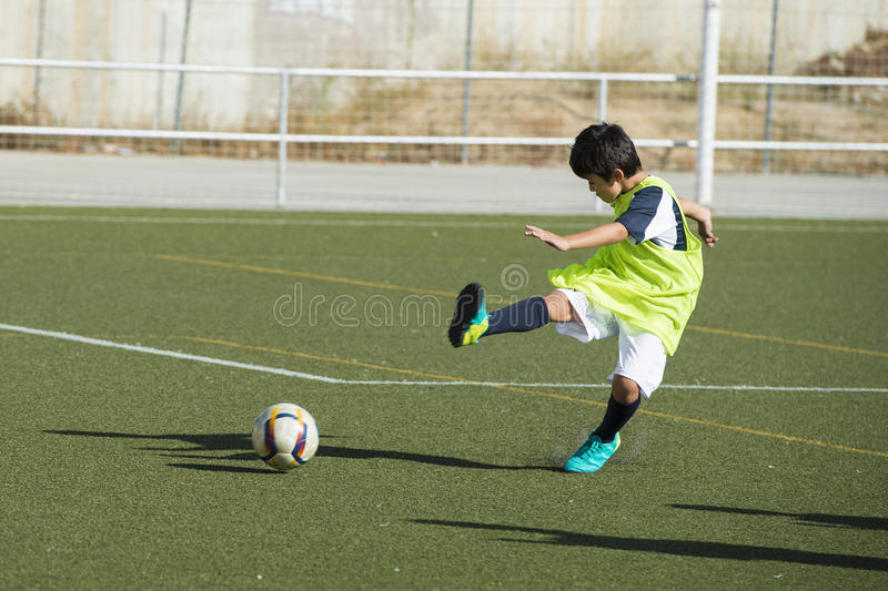 Young football player in a training stock photography