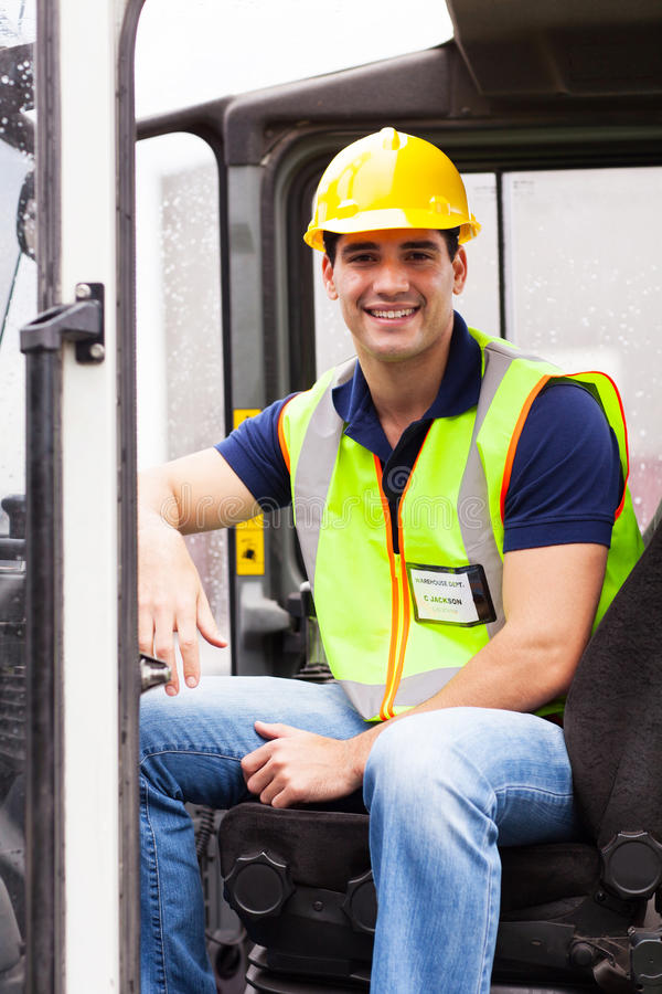 Young forklift driver. Portrait of smiling young forklift driver stock photography