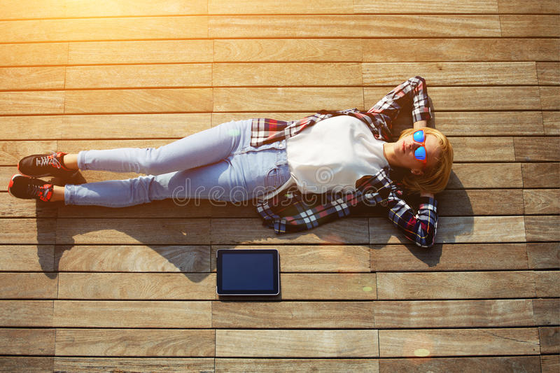 Young freelancer woman resting after work with digital tablet outdoors royalty free stock photo
