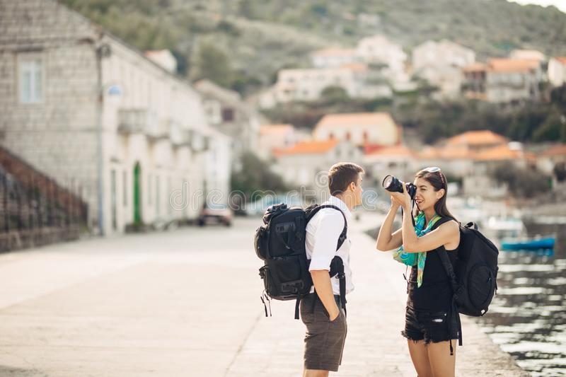 Young freelancing photographers enjoying traveling and backpacking.Photojournalism.Documentary travel photos.Lightweight travel royalty free stock images