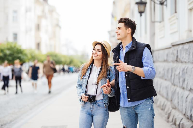 Young freelancing photographers enjoying traveling and backpacking. Young couple with backpack travel new destination stock photography