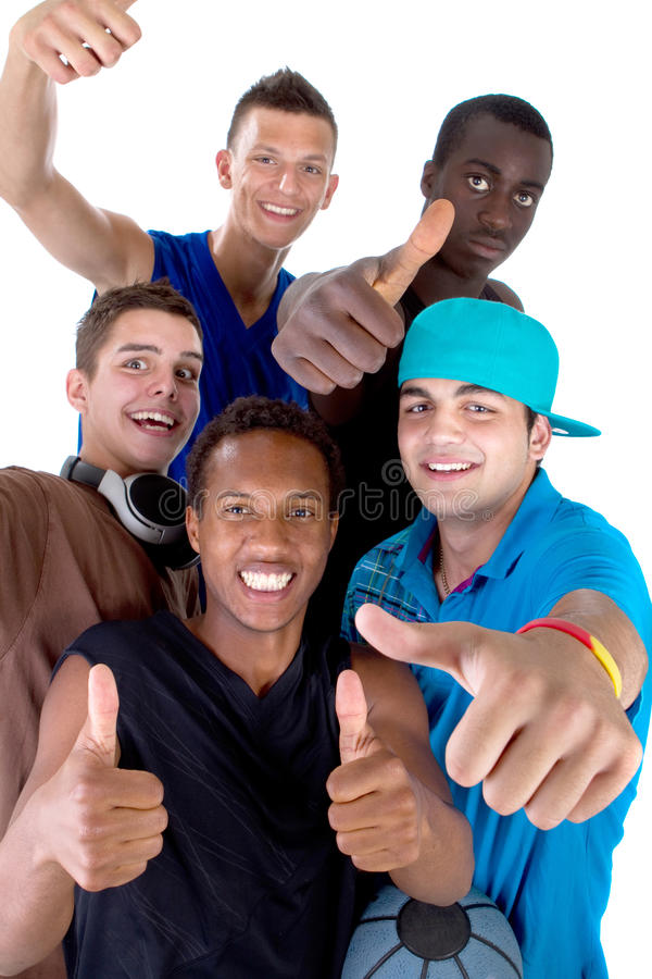 Young fresh group of teens. Young fresh interracial group of teenagers showing thumbs up sign as a sign of success. Isolated over white background stock photography