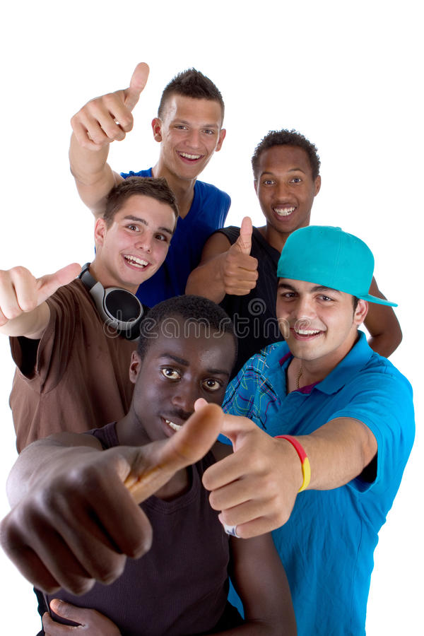 Young fresh group of teens. Young fresh interracial group of teenagers showing thumbs up sign as a sign of success. Isolated over white background royalty free stock image