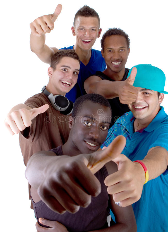 Young fresh group of teens. Young fresh interracial group of teenagers showing thumbs up sign as a sign of success. Isolated over white background royalty free stock photography