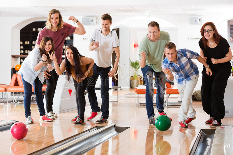Download Young Friends Bowling While People Cheering Stock Photo - Image: 37113452