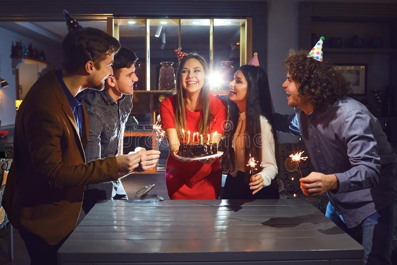 Young friends celebrating birthday stock photo