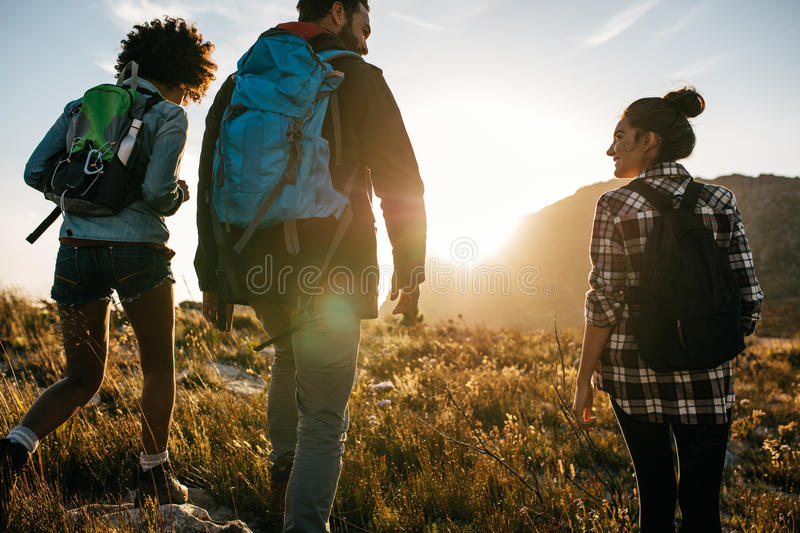Young friends on countryside hiking royalty free stock photo