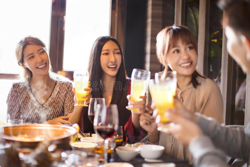 Young friends eating hot pot in restaurant stock image