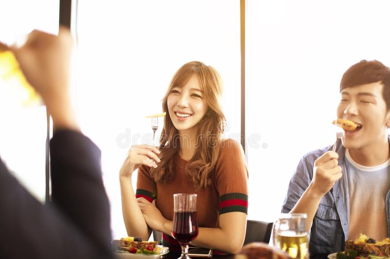 young friends enjoy dinner in restaurant. royalty free stock images
