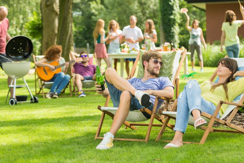 Young friends having barbecue picnic stock photography