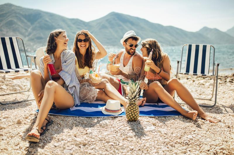 Friends having fun at the beach on a sunny day royalty free stock photography