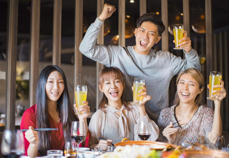 Friends having fun in hot pot restaurant stock image