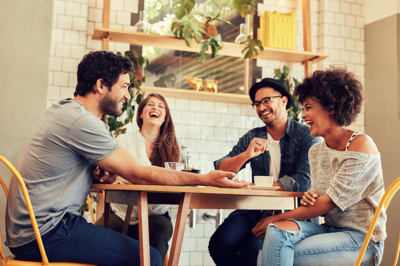 Young friends having a great time in restaurant stock photos