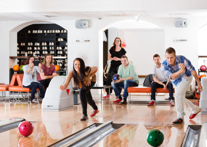 Young Friends Playing in Bowling Alley royalty free stock photography
