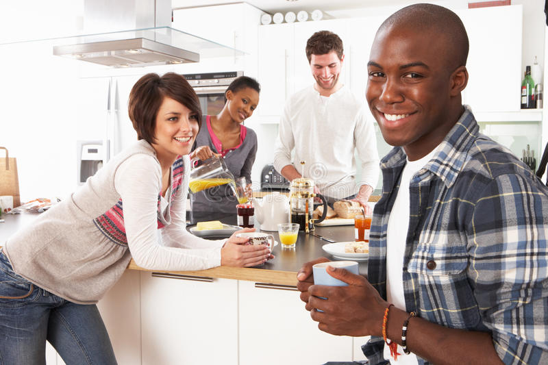 Download Young Friends Preparing Breakfast In Kitchen Stock Image - Image of glass, architecture: 14718739