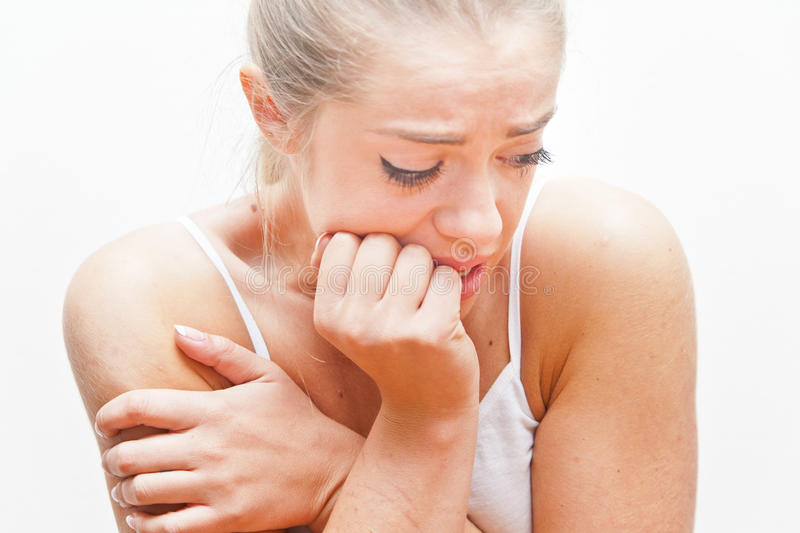 Young frightened woman expressing FEAR stock photo