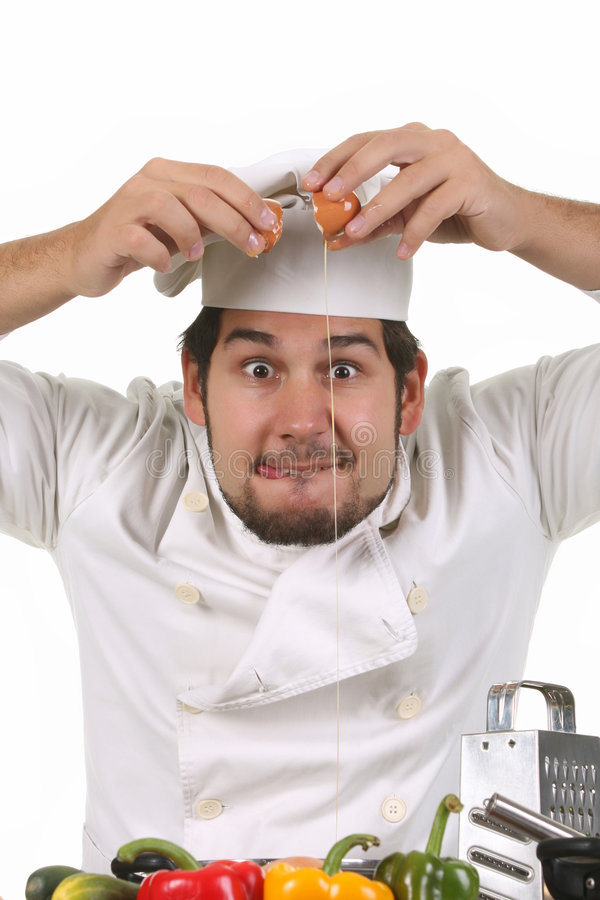 Free Young Funny Chef Cracking An Egg Royalty Free Stock Photography - 7033467