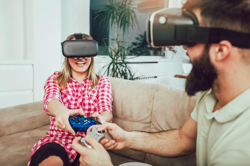 Young funny couple playing video games royalty free stock image