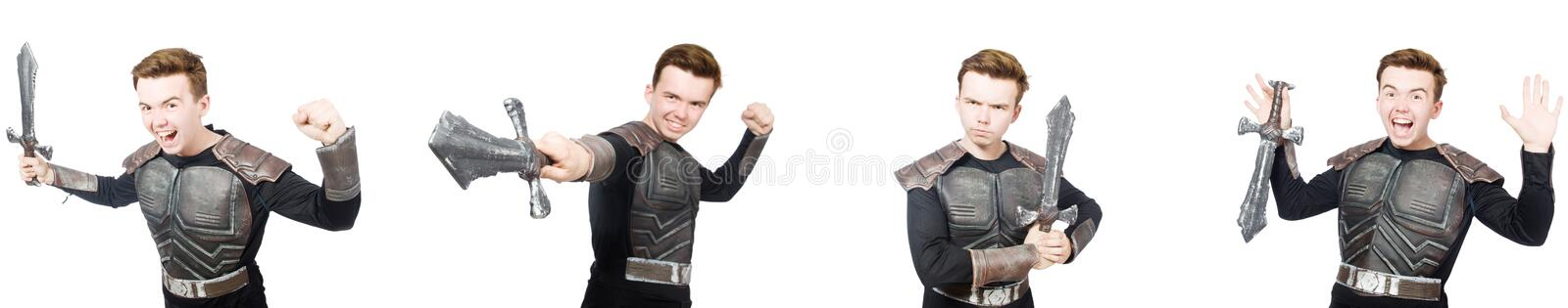 The young funny man in armour suit. Young funny man in armour suit royalty free stock photo