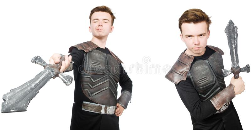 The young funny man in armour suit. Young funny man in armour suit royalty free stock image