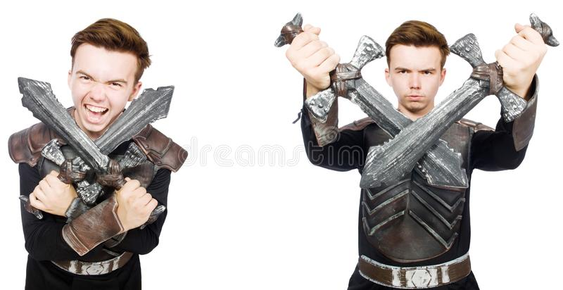 The young funny man in armour suit. Young funny man in armour suit royalty free stock photos