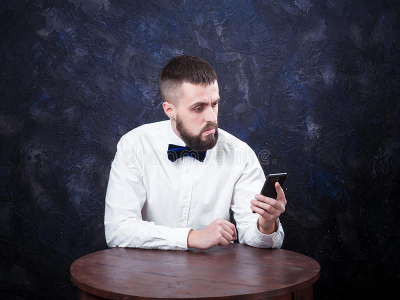 Young funny man with gift is preparing for the holiday 01 royalty free stock image