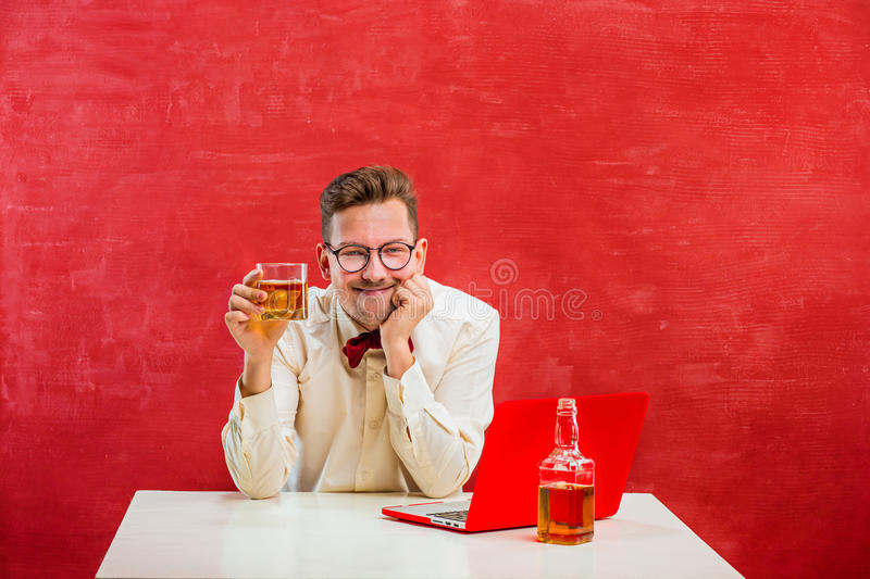 Young funny man with laptop at St. Valentine`s Day royalty free stock photography