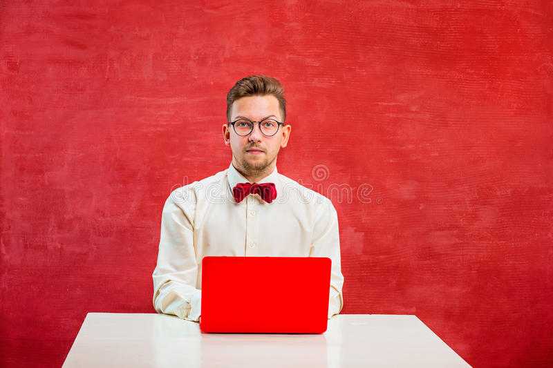 Young funny man with laptop at St. Valentine`s Day stock photo