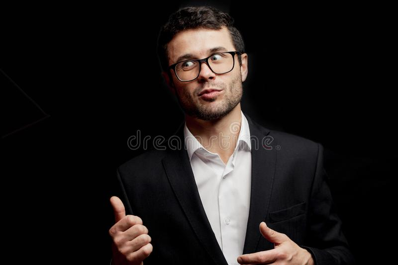 Young funny man looking back and showing thumbs up. Good-lloking guy is looking at passing beautiful girl royalty free stock photos