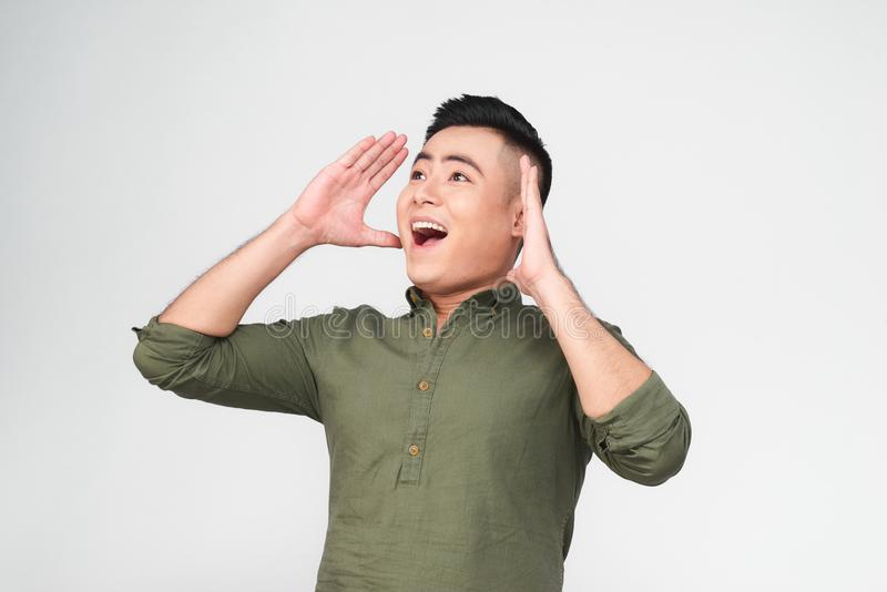Young funny shouting men holding his head in hands on white back royalty free stock images