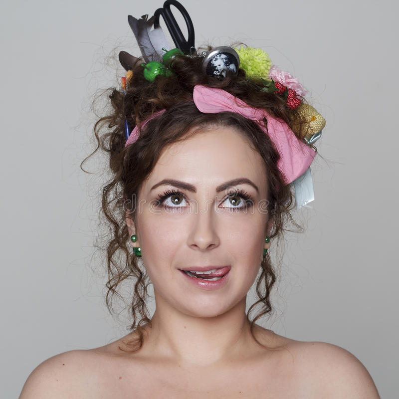 Young and funny woman with interesting and creative hairstyle. Portrait of young and funny woman with interesting and creative hairstyle royalty free stock photography