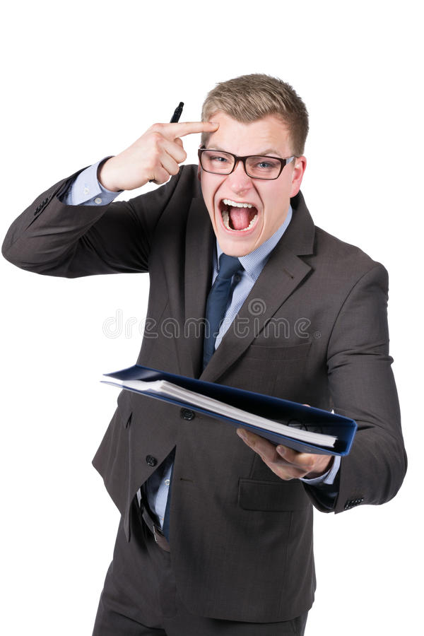 Young furious man is handing over a file. Cut out image of a young furious businessman who is handing over a blue file. The man is shouting and pointing to his royalty free stock photo