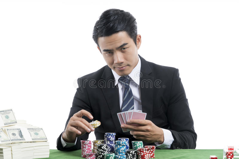 The young gambler is putting bets into the piles of chips royalty free stock photography